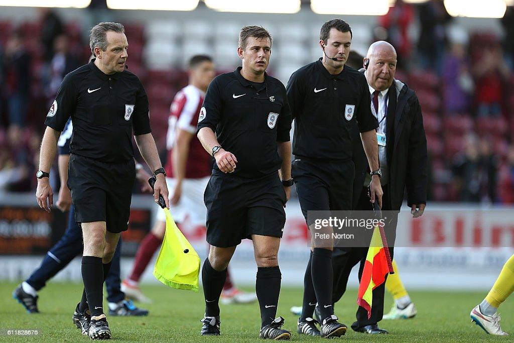 Replacment Referee Josh Smith (centre) and assistants Joe Clark (r) and John Law leave the pitch at the end of the game during the Sky Bet League One match between Northampton Town and Bristol Rovers at Sixfields Stadium on October 1, 2016 in Northampton, England.