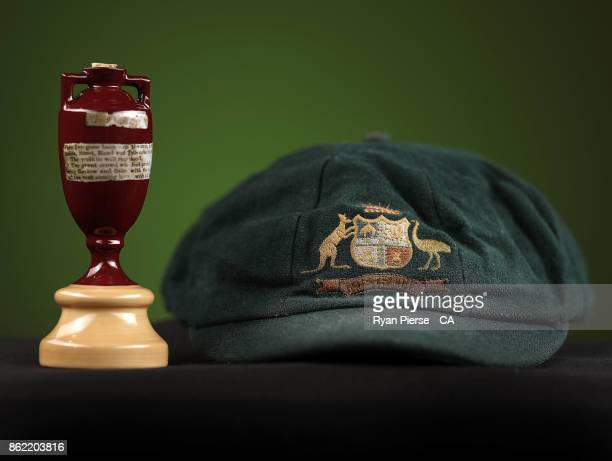 A replica Ashes Urn and a Australian Baggy Green Cap are seen during the Australia Test cricket team portrait session at Intercontinental Double Bay...