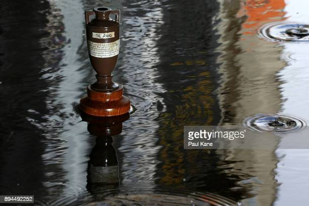 A replica Ashes urn is pictured in a puddle during day five of the Third Test match during the 2017/18 Ashes Series between Australia and England at...