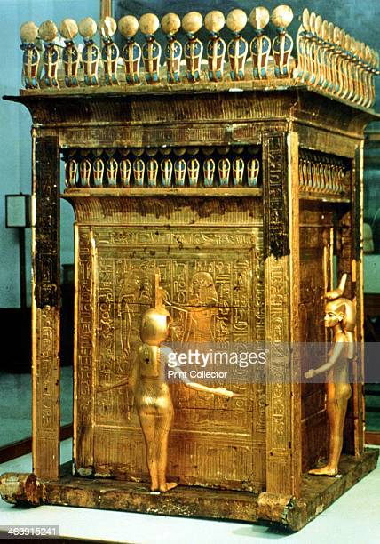 Replica canopic chest of gilded wood from the Tomb of Tutankhamun, Egypt. The original chest contained the organs which had been removed during...