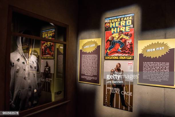 Replica comic covers and the bullet-holed sweatshirt from Luke Cage are on display on opening night of the Marvel: Universe of Super Heroes exhibit...