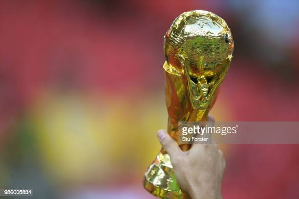 Replica FIFA World Cup trophy is held aloft during the 2018 FIFA World Cup Russia group E match between Serbia and Brazil at Spartak Stadium on June...