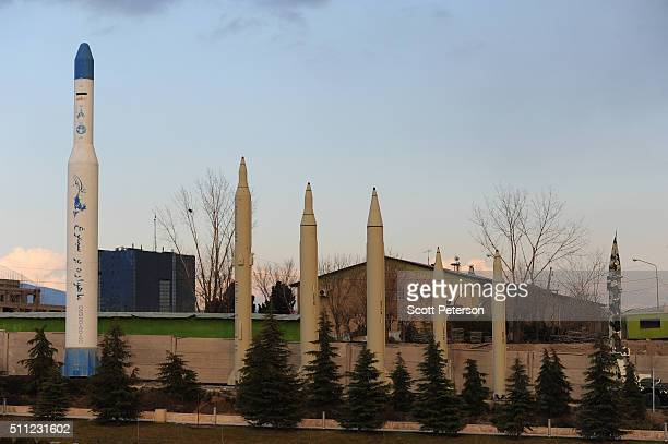 Replica Iranian missiles and a satellite launching rocket stand on display at the recently opened Holy/Sacred Defense Museum a vast complex created...