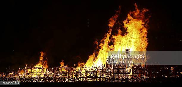 A replica of 17thcentury London on a barge floating on the river Thames burns in an event to mark the 350th anniversary of the Great Fire of London...