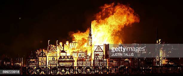 Replica of 17th-century London on a barge floating on the river Thames burns in an event to mark the 350th anniversary of the Great Fire of London,...