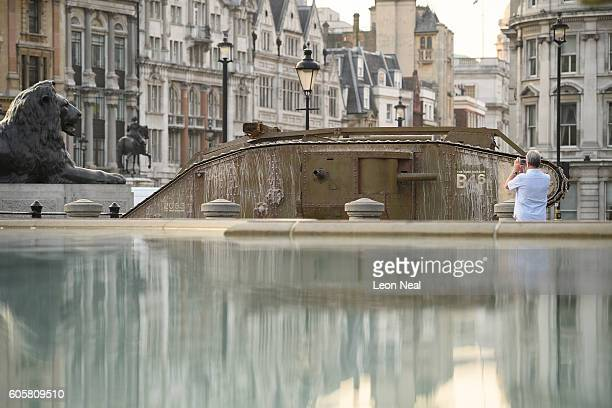 A replica of a British Mark IV tank is reflected in the water of the fountains as it is displayed in Trafalgar Square on September 15 2016 in London...