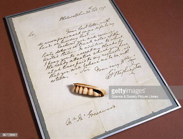 Replica of a set of dentures made for George Washington President of the United States The denture is shown with a copy of a letter written from him...