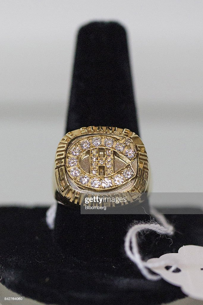 A replica of a Stanley Cup Championship ring belonging to notorious Boston mobster James 'Whitey' Bulger is displayed during a press preview before an asset-forfeiture auction in Boston, Massachusetts, U.S., on Friday, June 24, 2016. The U.S. Marshals Service auctioned off items seized in 2011 from the Santa Monica hideout of the Bulger and his girlfriend, Catherine Greig. Photographer: Scott Eisen/Bloomberg via Getty Images