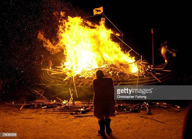 A replica of a Viking longboat burns January 27 2004 in Lerwick Shetland The traditional festival of fire known as Up Helly Aa takes place annually...