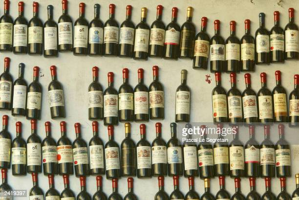 Replica of Bordeaux bottles are seen in a shop August 22 2003 in Saint Emilion outside BordeauxHarvesting of some of France's most prestigious wine...