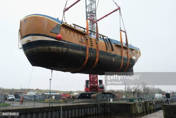Replica of Captain Cook's famous ship, HM Bark Endeavour, is hoisted by crane over the lock gates on the River Tees barrage as it undergoes...