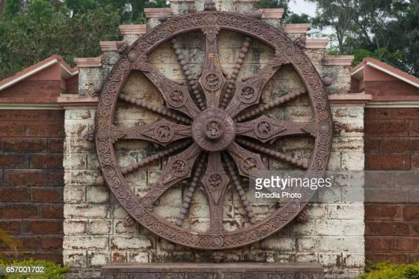 replica of chariot wheel at urban haat handicraft shop at konark, orissa, india, asia - chariot wheel stock photos and pictures