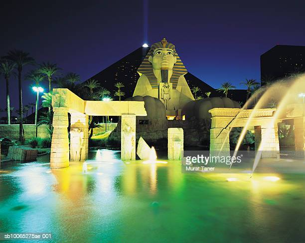 replica of  egyptian sphinx statue at night - luxor hotel stock pictures, royalty-free photos & images