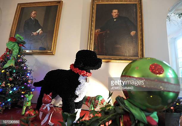 A replica of First Family dog Bo is pictured with other holiday decorations during a media walkthrough of the holiday decorations at the White House...