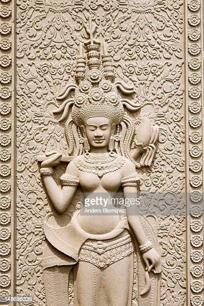 replica of heavenly maiden or apsara with elaborate hairstyle in the royal palace compound. - classical mythology character stock photos and pictures