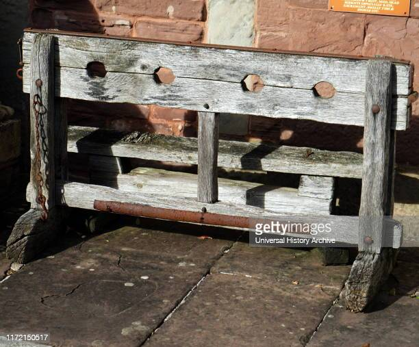 A replica of medieval wooden stocks Stocks were restraining devices used as a formal of corporal punishment and public humiliation