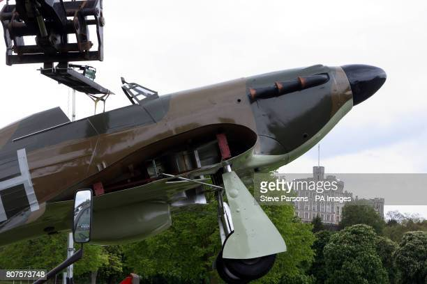 A replica of Sir Sydney Camm's Hawker Hurricane is lowered into place in the grounds of Windsor Castle in Berkshire as part of the 70th Anniversary...