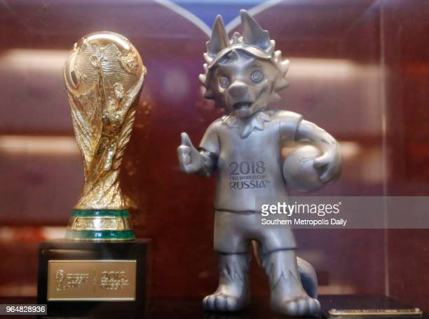 A replica of The 2018 FIFA World Cup trophy and a figurine of wolf Zabivaka the official mascot for the 2018 FIFA World Cup are on display at...