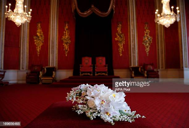 Replica of the Coronation Bouquet is presented to Queen Elizabeth II by the Worshipful Company of Gardeners in the Throne Room against the backdrop...
