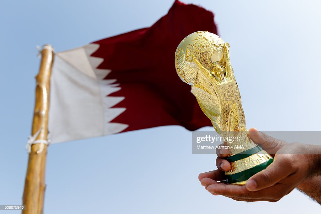 A replica of the FIFA World Cup Trophy in front of the maroon and white coloured flag of Qatar at the Al Zubarah Fort, a UNESCO World Heritage Site, in Madinat ash Shamal, Qatar. The country of Qatar is the host nation for the FIFA 2022 World Cup on January 25, 2016 in Qatar.