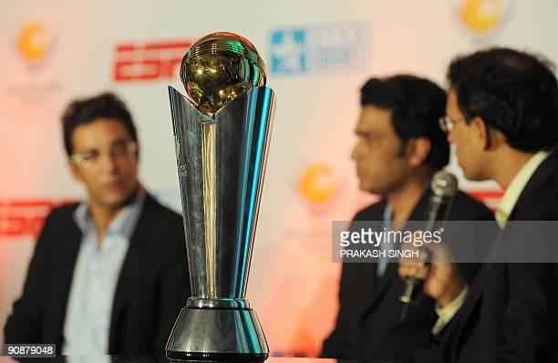 A replica of The International Cricket Council Champions Trophy on display as ESPN Star sports Commentators Harsha Bhogle Sanjay Manjrekar and Wasim...