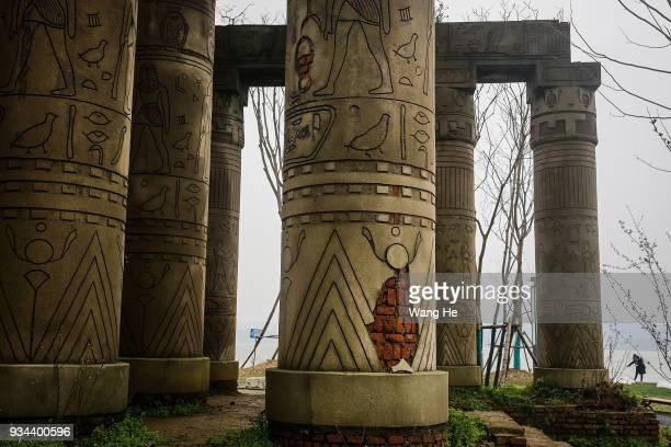 A replica of the Karnak Temple in Egypt stands at the abandoned Wanguo Park on March 19 2018 in Wuhan Hubei province China The park replicas were...