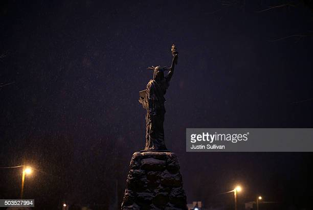 A replica of the Statue of Liberty stands in a park as snow falls on January 5 2016 in Burns Oregon An armed antigovernment militia group continues...