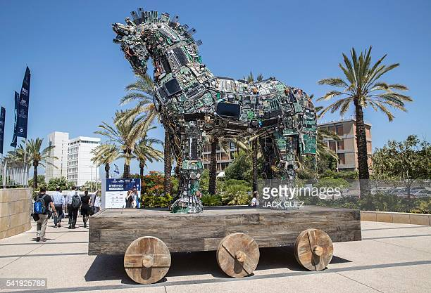 A replica of the Trojan horse designed by 'No No No No No Yes' and made up of thousands of computer and mobile phone components infected with various...