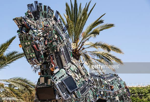A replica of the Trojan horse made up of thousands of computer and mobile phone components infected with various viruses and malware named the 'Cyber...