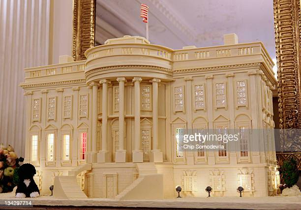 A replica of the White House made from 400pounds of gingerbread white chocolate and marzipan is on display in the State Dining Room during the first...