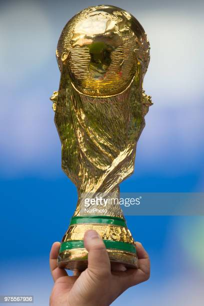 A replica of the World Cup Trophy is seen during the 2018 FIFA World Cup Russia group B match between Morocco and Iran at Saint Petersburg Stadium on...