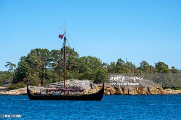 replica of vikingship gaia in the fjord of sandefjord norway - island in the background - finn bjurvoll stock pictures, royalty-free photos & images