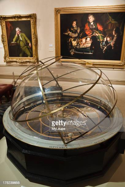 Replica orrery in front of Joseph Wright's painting 'The Orrery' Joseph Wright gallery Derby Museum and Art Gallery Derby Derbyshire England