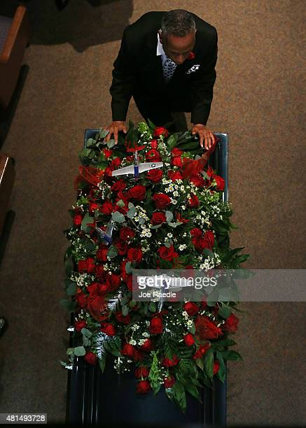Replica P51 Mustang World War II fighter planes are seen along with flowers atop the casket of retired Air Force Lt Col Eldridge Williams during his...