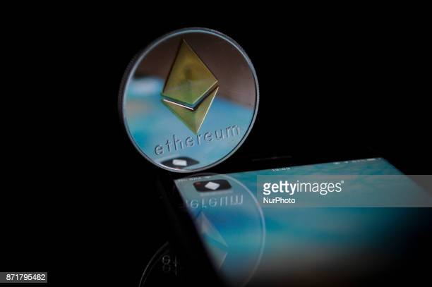 A replica quotetherquot cryptocurrency coin in seen in this photo illustration on November 8 2017 Ether is a token in a distributed network computing...