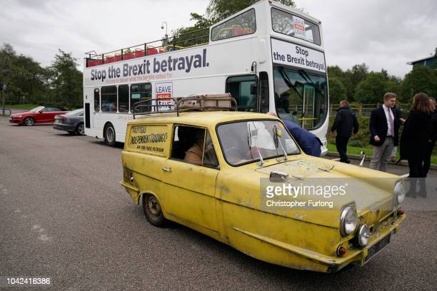 A replica Reliant Robin from the TV sries 'Only Fools and Horses' arrives in front of the proBrexit 'Leave Means Leave' battle bus as it campaigns on...