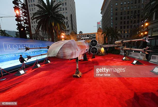 A replica Xwing fighter from the Star Wars movie franchise is parked on the red carpet at the premiere of Walt Disney Pictures and Lucasfilm's Rogue...
