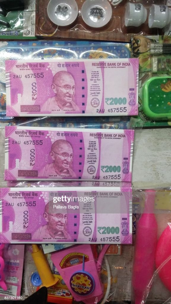 Replica's of new Indian currency notes on sale at a roadside shop The Indian economy was hit by the demonitisation move of the government in 2016