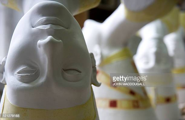 Replicas of the bust of Nefertiti are placed on a table before being painted at the Replica Workshop of the National Museums of Berlin in Berlin...