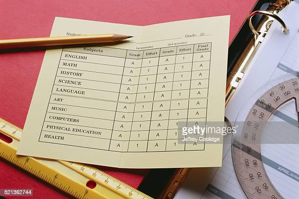 report card and school supplies - boletim escolar imagens e fotografias de stock