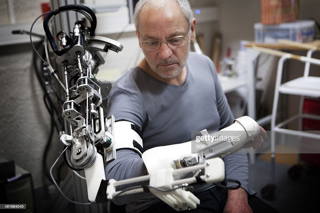 Reportage at ISIR (Institute of Robotics and Intelligent Systems) in Paris, France. Exoskeleton prototype used for neuro-motor rehabilitation and physical therapy. ABLE is an arm exoskeleton which is in contact with the human arm in multiple location : News Photo