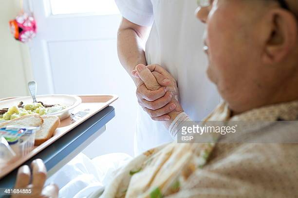 Reportage in Bligny hospital palliative care unit Briis sous Forges France An auxiliary nurse looks after a patient