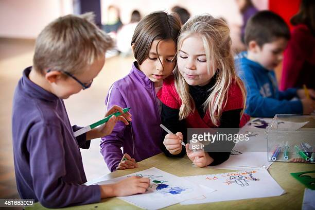 Reportage in Les Helices Vertes primary school in Cerny France Year 2 and year 3 pupils during break time