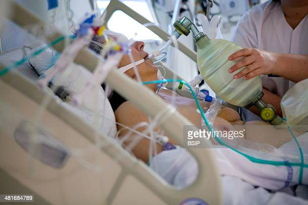 Reportage in Robert Ballanger hospital's Intensive Care Unit in France A doctor uses a hand pump on a patient