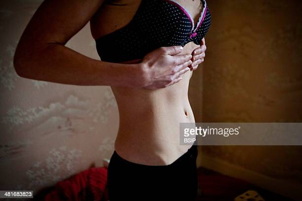 Reportage on a woman suffering from anorexia. Christel has suffered from anorexia for 2 years. Her body mass index is 16.7 and is extremely thin. She...