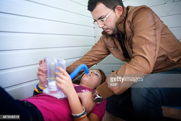 Reportage on Lara who suffers from cystic fibrosis She goes to school like any child of her age but has to have treatment throughout the day Her...