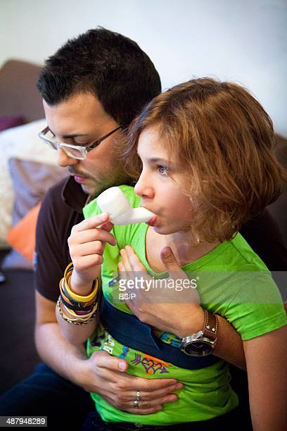 Reportage on Lara who suffers from cystic fibrosis She is cared for by a physiotherapist who gives her respiratory physiotherapy every day at home...