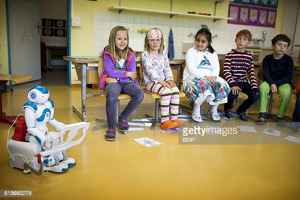 Reportage on the Avatar Kids project, which allows children and teenagers who have to be hospitalised to be present in the classroom through Nao, a...