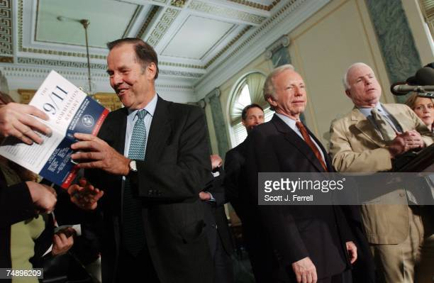 REPORTCommission Chairman Thomas H Kean signing autographs Sen Evan Bayh DInd Sen Joseph I Lieberman DCt commission Vice Chair Lee H Hamilton Sen...