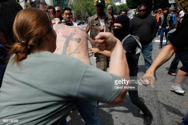 A reportedly homeless man is attacked by antineoNazi demonstrators before the start of a rally by the National Socialist Movement neoNazi group near...